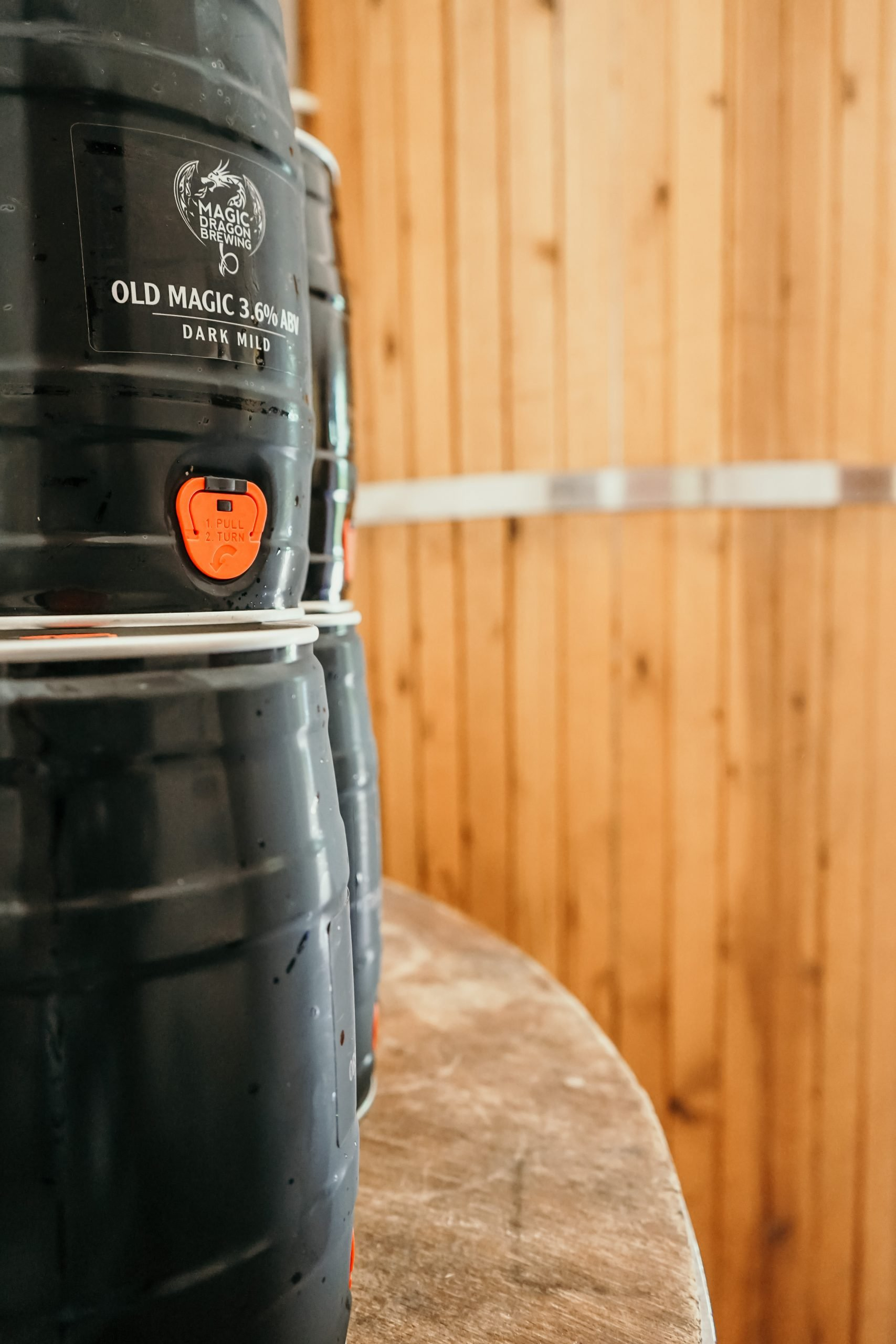 https://magicdragonbrewing.com/wp-content/uploads/2021/07/mini-kegs-in-brewery-scaled.jpg